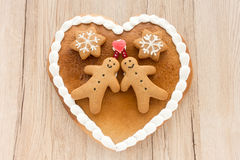 Gingerbread Heart on Light Brown Wooden Background Stock Image