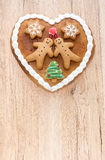 Gingerbread Heart on Light Brown Wooden Background Royalty Free Stock Photography