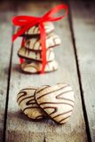 Gingerbread heart with red ribbon Stock Image