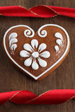 Gingerbread heart and ribbon Royalty Free Stock Image