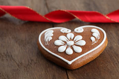 Gingerbread heart and ribbon Stock Image
