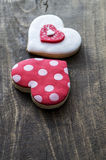 Gingerbread heart  on rustic wooden background. Royalty Free Stock Image
