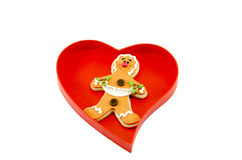 Gingerbread in a heart shaped box isolated on white Royalty Free Stock Photo