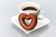 Gingerbread heart to the coffee cup. Gingerbread heart with coffee as a love symbol Stock Images