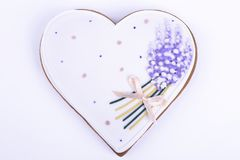 Gingerbread heart on white background. Gingerbread in the shape of heart . Gingerbread with painted flowers stock image