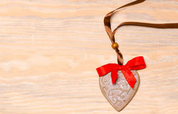 Gingerbread heart on a wooden background Royalty Free Stock Images