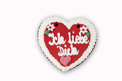 Gingerbread heart with writing ich liebe Dich on white background Royalty Free Stock Photos
