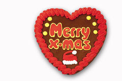 Gingerbread heart with writing Merry x-mas on white background Royalty Free Stock Photos