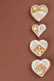 Gingerbread hearts on brown Royalty Free Stock Images
