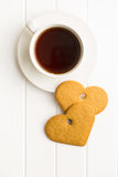 Gingerbread hearts and cup of coffee. Royalty Free Stock Photography