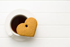 Gingerbread hearts and cup of coffee. Royalty Free Stock Photo