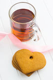 Gingerbread hearts and cup of tea. Royalty Free Stock Photos