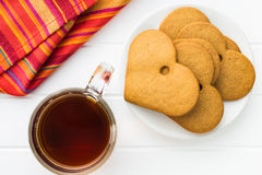 Gingerbread hearts and cup of tea. Royalty Free Stock Photography