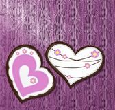 Gingerbread hearts on lacquered wood Royalty Free Stock Images