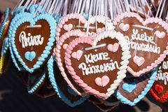 Gingerbread hearts. Prince and princess gingerbread hearts at Oktoberfest in Munich Germany Royalty Free Stock Image