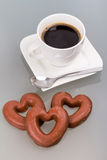 Gingerbread hearts to the coffee. Gingerbread heart with coffee as a love symbol Stock Photo