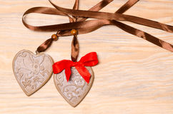 Gingerbread hearts on a wooden background Royalty Free Stock Photos