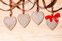 Gingerbread hearts on a wooden background Royalty Free Stock Image