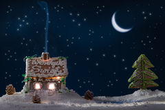 Gingerbread home with blue smoke royalty free stock photo