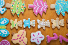 Gingerbread homemade cookies with icing colored drawings on wood Royalty Free Stock Image