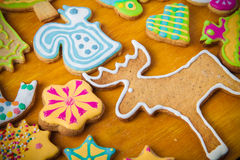 Gingerbread homemade cookies with icing colored drawings on wood Royalty Free Stock Photo