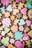 Gingerbread homemade cookies with icing colored drawings on wood Stock Photo