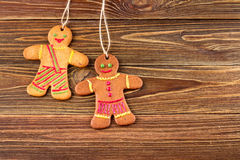Gingerbread homemade man on wooden background, Christmas or New Year background Stock Images