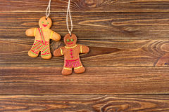 Gingerbread homemade man on wooden background, Christmas or New Year background Stock Photo