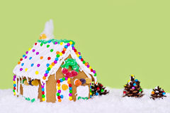 Gingerbread house. With cotton smoke coming from a gumdrop chimney royalty free stock photos