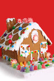 Gingerbread house. Christmas gingerbread house on a red background stock photos