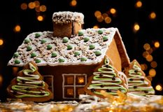 Gingerbread house. With lights inside, dark background royalty free stock photos