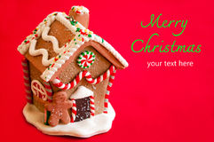 Gingerbread House. On red background stock photography