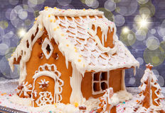 Gingerbread House. With lights inside, dark background stock photography