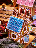 Gingerbread House with blue roof in foreground. Royalty Free Stock Photography