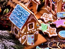 Gingerbread House with blue roof in foreground. Stock Image