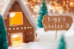 Gingerbread House, Bronze Background, Text Happy Weekend. Gingerbread House In Snowy Scenery As Christmas Decoration. Christmas Trees And Candlelight For Royalty Free Stock Photo
