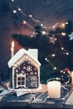 Homemade gingerbread house decorated with candles and Christmas lights stock photography