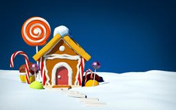 Gingerbread house on snow field Stock Photography