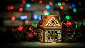 Gingerbread house and Christmas decorations on festive backgrou. Nd.photo with copy space Stock Images