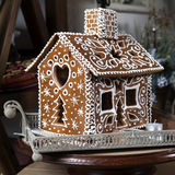 Gingerbread house and christmas spices Royalty Free Stock Images