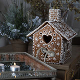 Gingerbread house and christmas spices Royalty Free Stock Photo