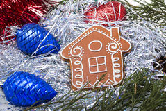 Gingerbread house with christmas toys and tinsel Stock Photography