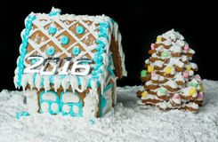 Gingerbread house and christmas tree Stock Photo