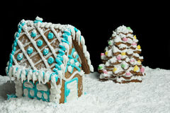Gingerbread house and christmas tree Royalty Free Stock Image