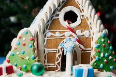 Gingerbread house with Christmas trees Royalty Free Stock Photos