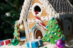 Gingerbread house with Christmas trees Stock Image