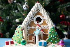 Gingerbread house with Christmas trees Royalty Free Stock Images