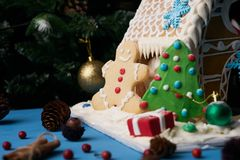 Gingerbread house with Christmas trees Royalty Free Stock Image