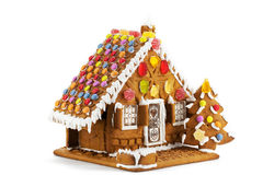 Gingerbread house. Colorful gingerbread house isolated against white background stock photo