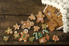 Gingerbread house and cookie assortment stock photography